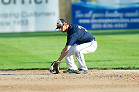 KELOWNA, BC - JULY 24:  A player of the the Kelowna Falcons stops a ground ball against the Yakima Valley Pippins at Elks Stadium on July 24, 2019 in Kelowna, Canada. (Photo by Marissa Baecker/Shoot the Breeze)