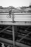 Picture by Andrew Tobin/Tobinators Ltd +44 7710 761829<br /> 04/08/2013<br /> A rider crosses the bridge during the Cycle Messenger World Championships held in Lausanne, Switzerland. Started in 1993 by Achim Beier from Berlin, the championships are not only a sporting contest but an opportunity to unite friends and bicycle enthusiasts worldwide. The event comprises a number of challenges including a sprint, a track stand (longest time stationary on the bike), a cargo race where heavy loads are carried on special bikes, and the main race. The course winds through central Lausanne and includes bridges, stairs, cobbles, narrow alleyways and challenging hills. The main race simulates the job of a bike courier making numerous drops and pickups across the city. Riders need to check in at specific checkpoints, hand over their delivery and get a new one. The main race can take up to 4 hours for each competitor to complete.