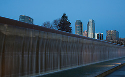 North America, United States, Washington, Bellevue, fountain in Bellevue Downtown Park and skyscrapers at dusk