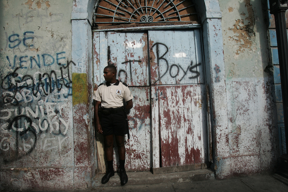 "A policeman patrols in Casco Viejo, the colonial part of Panama City which is being revitalized.  There are now various shops and restaurants, though much  of the area is still run down.  Panama is poised to become the ""next Costa Rica"", though tourists have yet to begin flocking to the central american country.  The Capital, Panama City, is home to the Panama Canal and, due to the former US military presence, is one of the continents capitals most comfortable for people from the United States.  The country offers a variety of eco-tourism opportunities as well as a capital that mixes a modern feel with a colonial center."