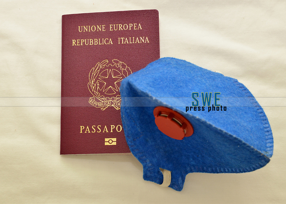 Italian passport and mask, for protection from the coronavirus (covid19)