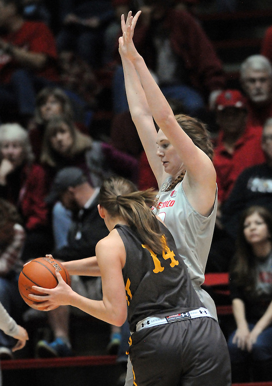 jt022517k/sports/jim thompson/UNM's #32 Kianna Keller stops the drive of Wyoming's #14 Natalie Baker in their game Saturday  in the Pit. Saturday Feb.25, 2017. (Jim Thompson/Albuquerque Journal)