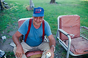 Intoxicated man in a backyard in Beardstown, Illinois