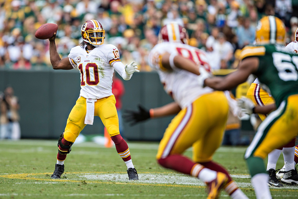 GREEN BAY, WI - SEPTEMBER 15:  Robert Griffin III #10 of the Washington Redskins throws a pass against the Green Bay Packers at Lambeau Field on September 15, 2013 in Green Bay, Wisconsin. The Packers defeated the Redskins 38-20.  (Photo by Wesley Hitt/Getty Images) *** Local Caption *** Robert Griffin III