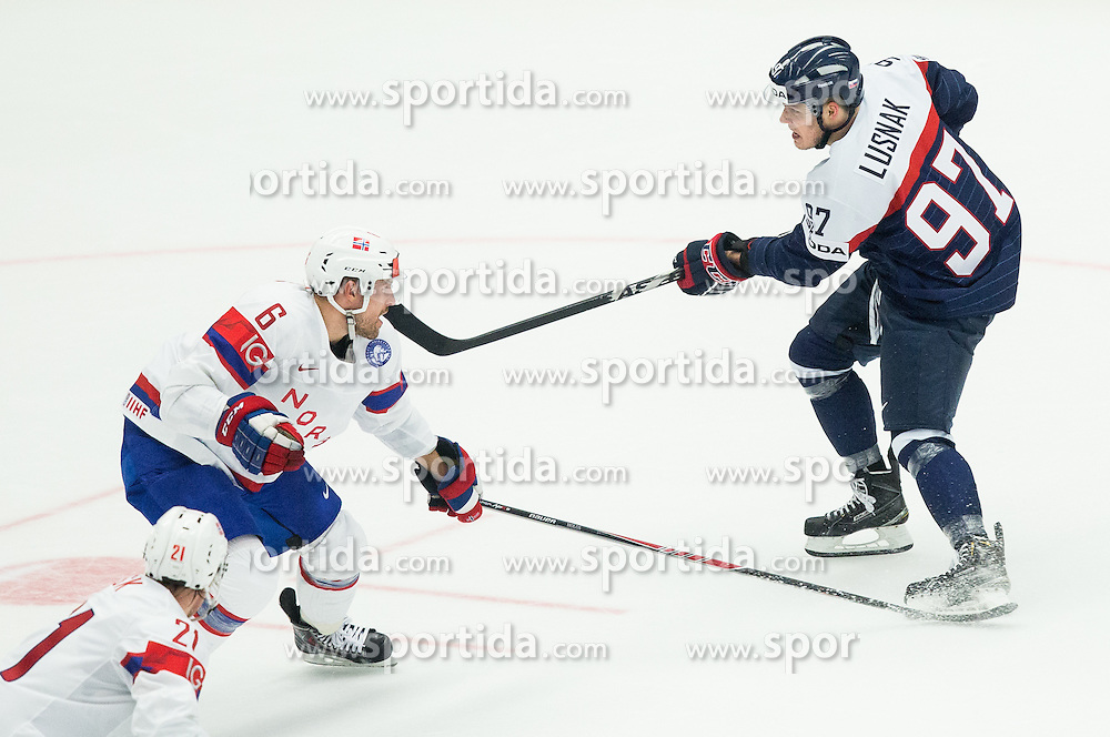 Jonas Holos of Norway vs Patrik Lusnak of Slovakia during Ice Hockey match between Slovakia and Norway at Day 6 in Group B of 2015 IIHF World Championship, on May 6, 2015 in CEZ Arena, Ostrava, Czech Republic. Photo by Vid Ponikvar / Sportida
