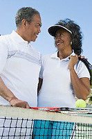 Couple with tennis equipment