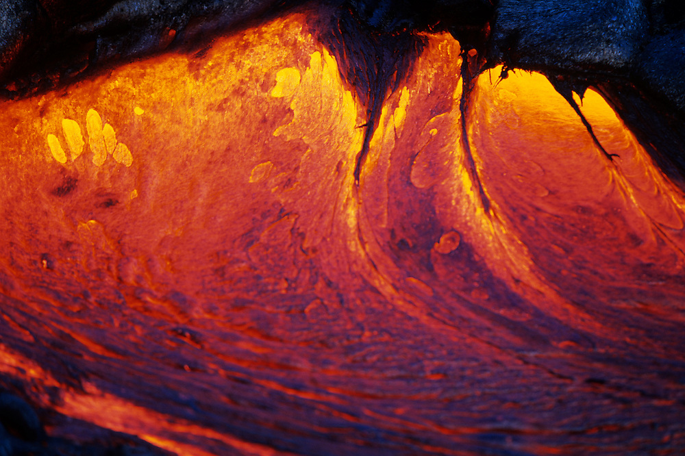USA, Hawaii, Volcanoes National Park,  Detail of glowing stream of molten lava at dusk during eruption of Kilauea volcano