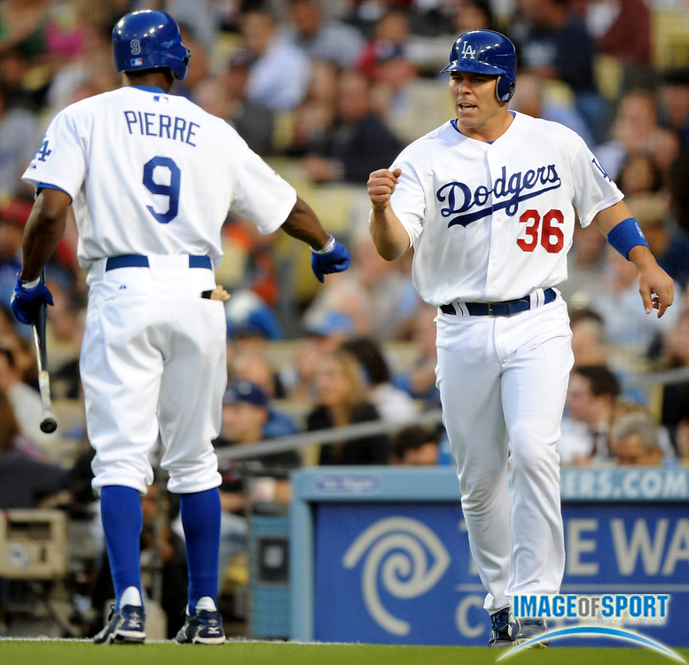 June 2, 2008; Los Angeles, CA, USA; Los Angeles Dodgers catcher Danny Ardoin (36), right, is congratulated by left fielder Juan Pierre (9) after scoring in the second inning of 8-1 victory over the Colorado Rockies at Dodger Stadium.