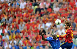 (L) Itay's Mario Balotelli (nr09) fights for the ball with (R) Spain's Sergio Ramos (nr15) during their the UEFA EURO 2012 Group C football match between Spain and Italy at Gdansk Arena in Gdansk on June 10, 2012...Poland, Gdansk, June 10, 2012..Picture also available in RAW (NEF) or TIFF format on special request...For editorial use only. Any commercial or promotional use requires permission...Photo by © Adam Nurkiewicz / Mediasport