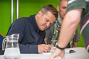 Forest Green Rovers manager, Mark Cooper signs an autograph at Forest Green Rovers fans forum at The New Lawn, United Kingdom on 22 September 2017. Photo by Shane Healey.