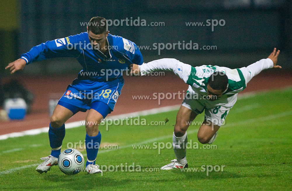 Sasa Kovjenic of Domzale vs Joao Gabrijel Da Silva of Olimpija at football match of 15th Round of Slovenian Prva Liga between NK Domzale vs NK Olimpija, on October 28, 2009, in Sports park Domzale, Domzale, Slovenia.   (Photo by Vid Ponikvar / Sportida)