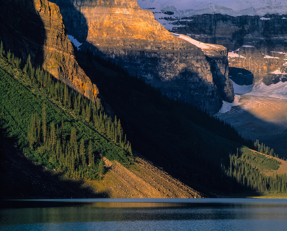 Sunlight colors the walls of Lake Louise in Banff National Park, Alberta, Canada. ©Ric Ergenbright