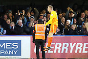 Jason McCarthy of Wycombe Wanderers runs the full length of the pitch to celebrate his goal with the Wycombe Fans during the Sky Bet League 2 match between AFC Wimbledon and Wycombe Wanderers at the Cherry Red Records Stadium, Kingston, England on 21 November 2015. Photo by Stuart Butcher.