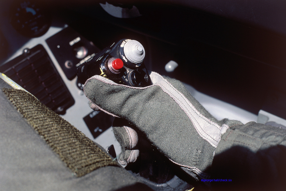 F-16 Falcon right-hand side-stick controller..Military pilots always wear Nomex fireproof gloves.