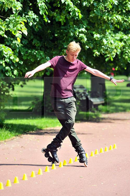 &copy; Licensed to London News Pictures. 09/06/2016<br /> Rollerblader enjoying the weather while praticing.<br /> Sunny weather in Greenwich Park,Greenwich,London  today (09/06/2016) <br /> <br /> <br /> <br /> (Byline:Grant Falvey/LNP)