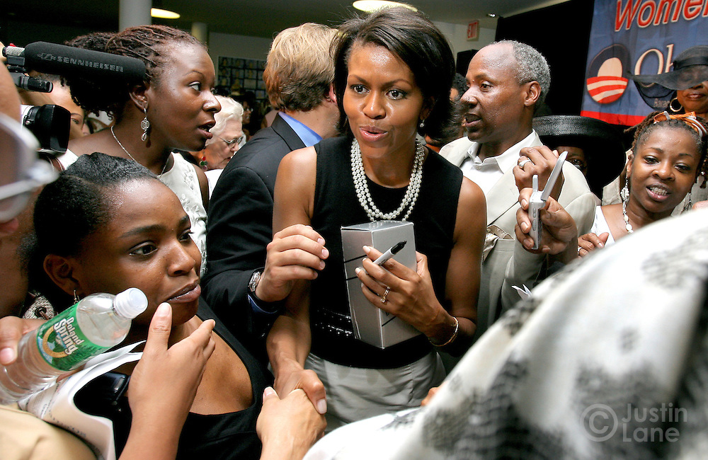Michelle Obama (C), the wife of US presidential candidate Barak Obama, shakes hands with supporters during a 'Women for Obama' event in the Harlem Neighborhood of New York, New York  on 26 June 2007.