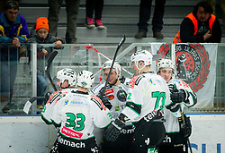 Players of Olimpija celebrate after scoring second goal during Ice hockey match between HDD SIJ Acroni Jesenice and HDD Telemach Olimpija in Main Round of Slovenian National Championship 2014/15, on October 28, 2014 in Arena Podmezakla, Jesenice, Slovenia. Photo by Vid Ponikvar / Sportida