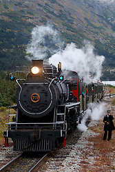 Steam train engine number 73 with conductor, White Pass and Yukon Route Railway, Skagway, Alaska, United States of America