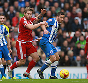 Brighton striker Tomer Hemed shields the ball from Middlesbrough FC midfielder Adam Clayton during the Sky Bet Championship match between Brighton and Hove Albion and Middlesbrough at the American Express Community Stadium, Brighton and Hove, England on 19 December 2015. Photo by Bennett Dean.