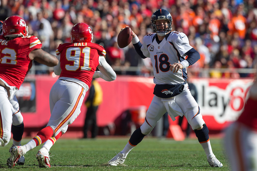 KANSAS CITY, MO - NOVEMBER 25: Peyton Manning #18 of the Denver Broncos rolls out to pass under pressure from Tamba Hali #91 of the Kansas City Chiefs at Arrowhead Stadium on November 25, 2012 in Kansas City, Missouri.  The Broncos defeated the Chiefs 17-9. (Photo by Wesley Hitt/Getty Images) *** Local Caption *** Peyton Manning; Tamba Hali