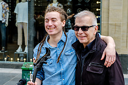 Cellist/singer/songwrite, Paisley born CALUM INGRAM (L) with record Producer TONY VISCONTI (Mark Bolan, Thin Lizzy, Morrisey, David Bowie) in Buchanan Street, Glasgow<br /> <br /> (c) Andrew Wilson | Edinburgh Elite media