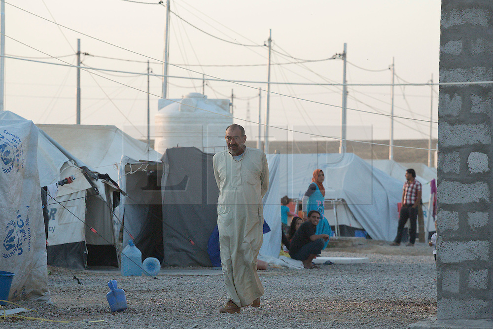 Licensed to London News Pictures. 22/10/2016. Iraqi refugees go about their business as the sun starts to go down on the Dibaga refugee camp near Makhmur, Iraq.<br /> <br /> The crowded Dibaga camp, housing around 28,000 Sunni Arab refugees, is the main gathering point for new IDPs now fleeing areas where ISIS have been pushed out or are in conflict with the Iraqi Army. Photo credit: Matt Cetti-Roberts/LNP