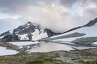 Whatcom Peak shrouded in clouds near upper Tapto Lake, North Cascades National Park Washington