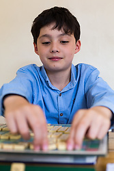 Reuben, 11, has just won the European youth Championship in Isai, Romania, winning 12 out of 13 games to take the title. Brothers Reuben and Josh Moisey are top level Scrabble Champions with 11 year-old Reuben crowned European Youth Scrabble Champion and 8 year-old Josh became World Under Eight Scrabble Champion in Dubai in 2018. London, August 15 2019.