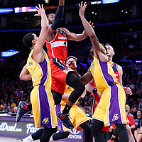 27 January 2015: Washington Wizards guard John Wall (2) goes for the layup past Los Angeles Lakers guard Jordan Clarkson (6) and Los Angeles Lakers center Jordan Hill (27) during the Washington Wizards 98-92 victory over the Los Angeles Lakers, at the Staples Center, Los Angeles, California, USA.