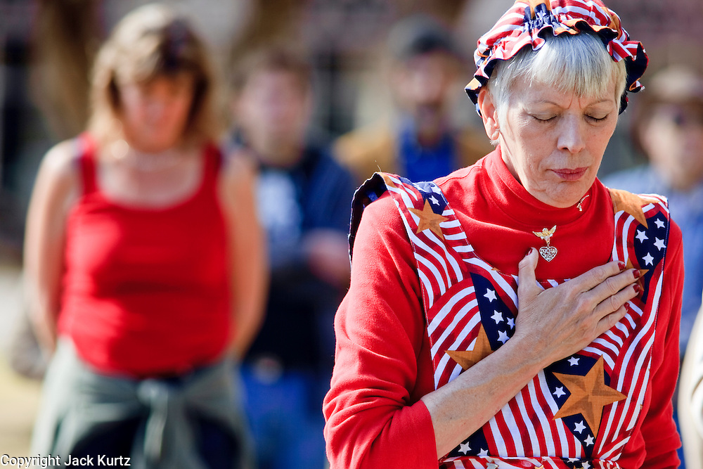 Feb. 14, 2009 -- PHOENIX, AZ: DONNA CHRISTINE PARK, from Mesa, AZ, prays during a peace vigil at the Arizona State Capitol Saturday. Arizona Statehood Day was admitted to the United States on Feb 14, 1912. Anti-war activists in Arizona marked the day this year with a peace vigil at the state capitol.  Photo by Jack Kurtz / ZUMA Press