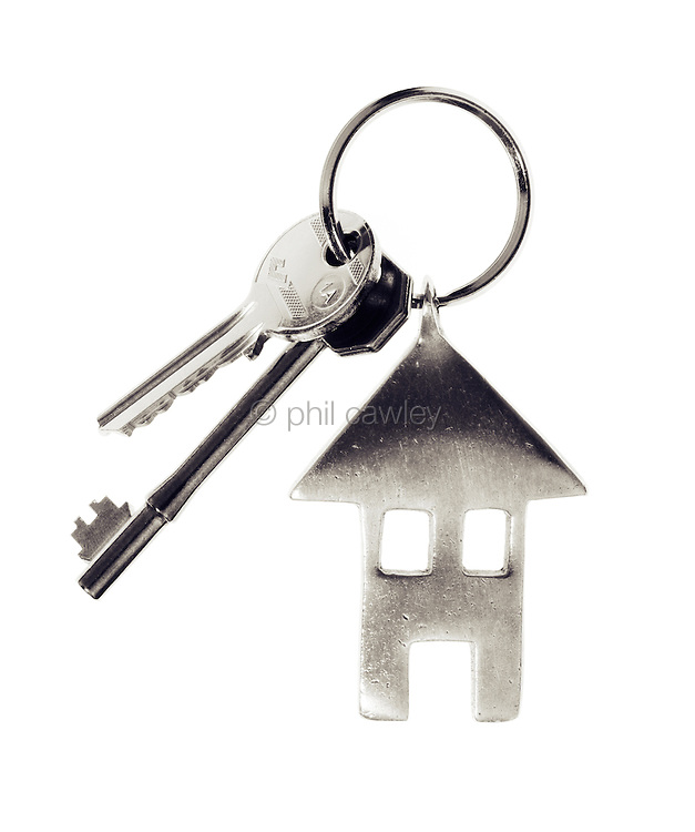 House keys with a house shaped key fob