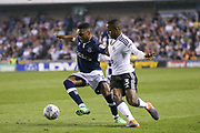 Millwall defender Mahlon Romeo (12) and Fulham defender Ryan Sessegnon (3) battle for the ball during the EFL Sky Bet Championship match between Millwall and Fulham at The Den, London, England on 20 April 2018. Picture by Toyin Oshodi.