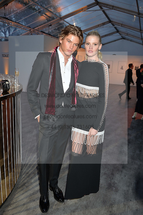 LARA STONE and JORDAN BARRETT at British Vogue's Centenary Gala Dinner in Kensington Gardens, London on 23rd May 2016.