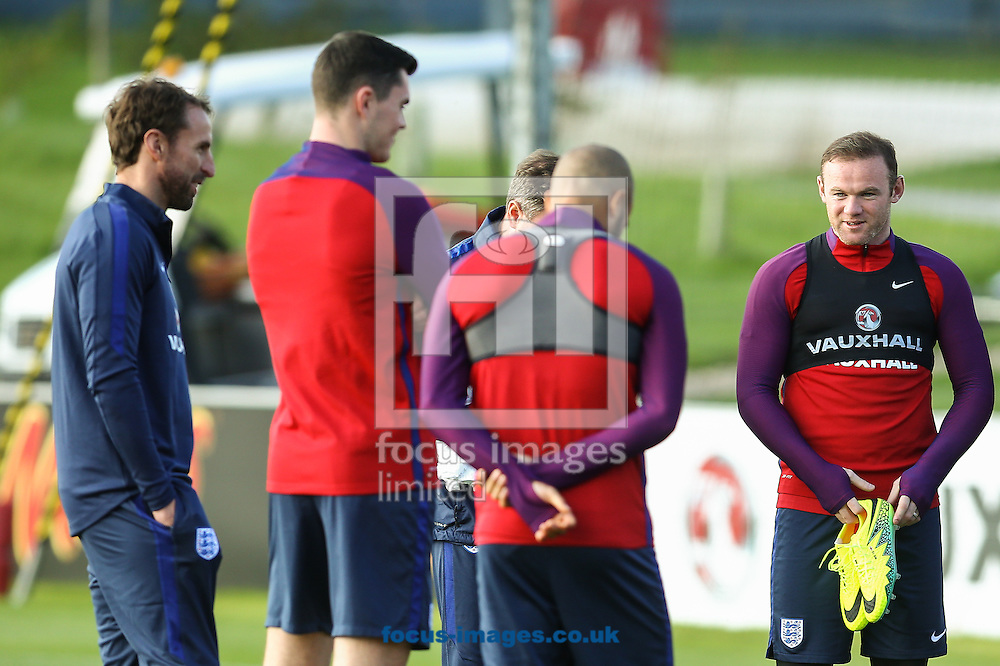 Wayne Rooney (Manchester United) (right) shares a joke during the England training session at St Georges Park, Burton upon Trent<br /> Picture by Andy Kearns/Focus Images Ltd 0781 864 4264<br /> 04/10/2016