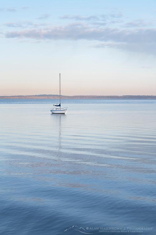 Sailboat anchored in Bellingham Bay on a calm morning, Bellingham,  Washington