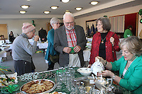 The Comer Children&rsquo;s Hospital Service League&rsquo;s annul Irish Coffee benefit and silent raffle was held this past Saturday at Augustana Lutheran Church located at 5500 S. Woodlawn.<br /> <br /> 0946 &ndash; David Seiberling and his wife Shannon enjoy a cup of Irish Coffee.