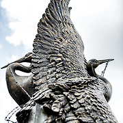 A bronze statue by Nina Akamu of cranes escaping from barbed wire in the center of the the Memorial to Japanese-American Patriotism in World War II near the US Capitol in Washington DC. The memorial was designed by Davis Buckley and Nina Akamu and commemorates those held in Japanese American internment camps during World War II.