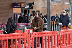 © Licensed to London News Pictures. 31/03/2020. London, UK. A shopper wears a face mask as he queues to enter a Sainsbury's supermarket in Charlton South east London. The Government has announced a lockdown to slow the spread of Coronavirus and reduce pressure on the NHS. Photo credit: George Cracknell Wright/LNP
