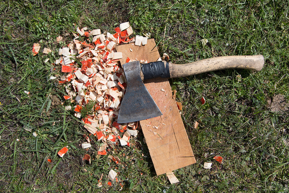 A hatchet sits on a piece of wood amid a pile of wood chips after being used to trim the polls for the frame of a traditional Mongolian Ger being set up at Lake Hovsgol on July 24, 2012.  © 2012 Tom Turner Photography