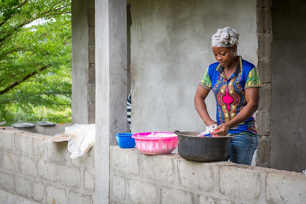 A woman prepares Cassava based Fufu dough in Ganta, Liberia
