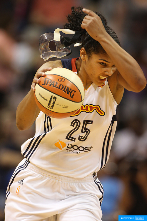 Alyssa Thomas, Connecticut Sun, playing with a face mask to protect her injured nose, loses her mask as she drives down the court during the Connecticut Sun Vs Tulsa Shock WNBA regular season game won by the Tulsa Shock 96-83 at Mohegan Sun Arena, Uncasville, Connecticut, USA. 3rd July 2014. Photo Tim Clayton
