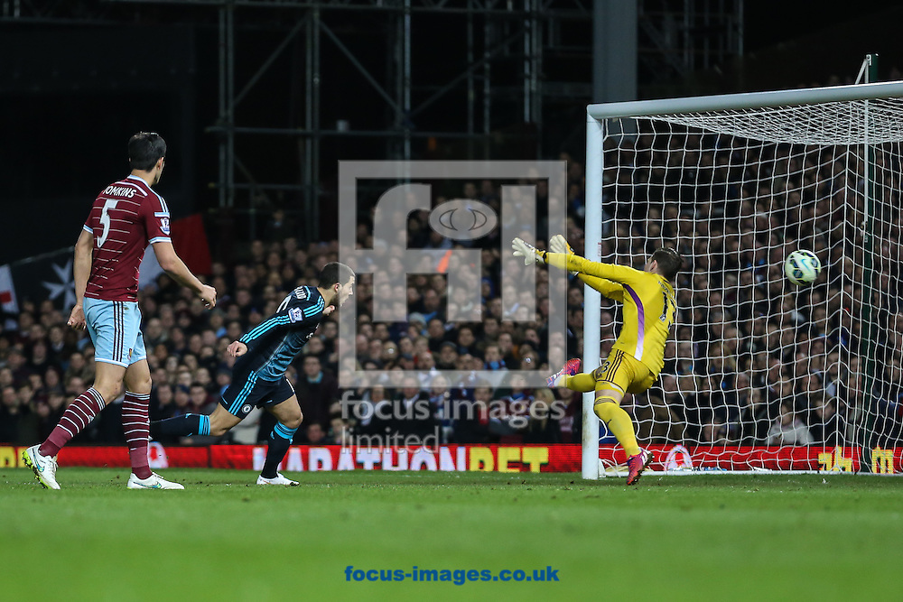 Eden Hazard of Chelsea (2nd left) scores the opening goal against West Ham United during the Barclays Premier League match at the Boleyn Ground, London<br /> Picture by David Horn/Focus Images Ltd +44 7545 970036<br /> 04/03/2015