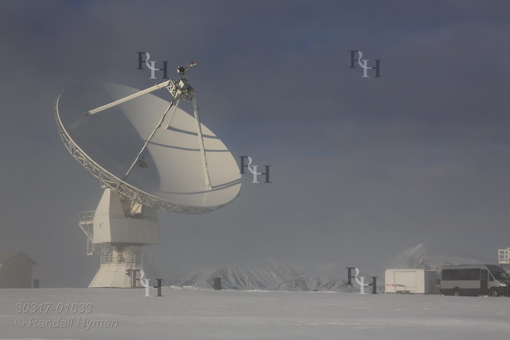 VLBI radio telescope points skyward at Hamarabben Airport above the international science village of Ny-Alesund on Spitsbergen island in Kongsfjorden; Svalbard, Norway.