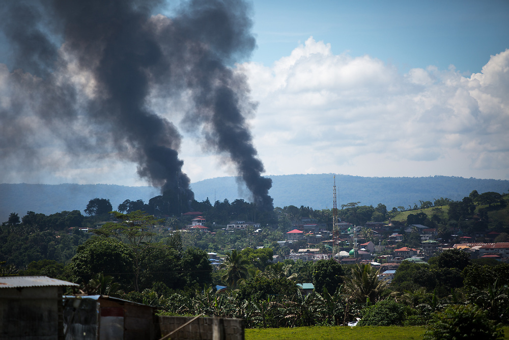 MARAWI, PHILIPPINES - JUNE 11: A smoke following an airstrikes by Philippine Air Force in Marawi city, southern Philippines on June 11, 2017. Philippine military jets fired rockets at militant positions on Sunday as soldiers fought to wrest control of the southern city from gunmen linked to the Islamic State group. (Photo: Richard Atrero de Guzman/NUR Photo)