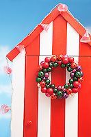 Beach storage cabin with christmas decoration on door