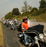 Harley Davidson bikers line up as they leave Hals Harley Davidson owner event Thursday Aug. 28, 2003 New Berlin  Wis. Thousands of Harley Davidson bikers from all over the world came to Wisconsin to help celebrate Harley Davidson 100th anniversary.   photo by Darren Hauck