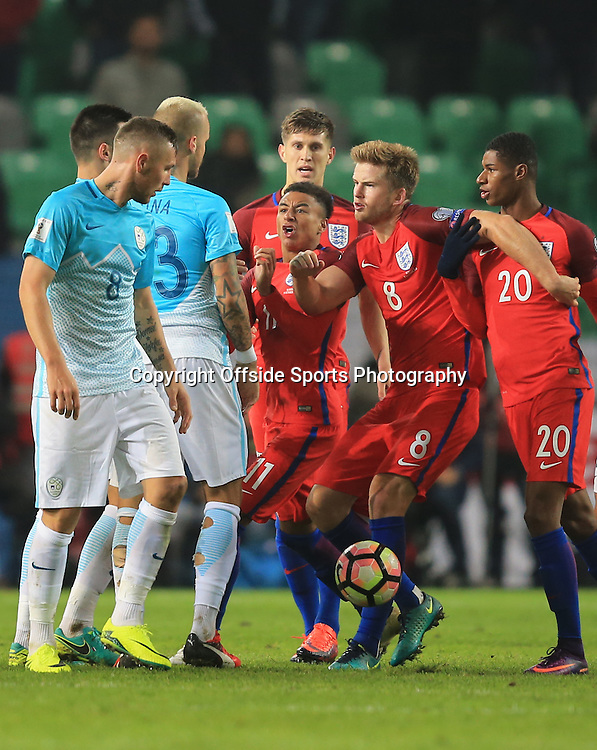11 October 2016 - FIFA 2018 World Cup Qualifying (Group F) - Slovenia v England - Tempers flare as Jesse Lingard, Eric Dier and Marcus Rashford of England  react toward Aljaz Struna of Slovenia - Photo: Marc Atkins / Offside.