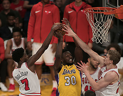 November 21, 2017 - Los Angeles, California, United States of America - Julius Randle #30 of the Los Angeles Lakers is blocked by Justin Holiday #7 and Lauri Markkanen #24 of the Chicago Bulls during their game on Tuesday November 21, 2017 at the Staples Center in Los Angeles, California. Lakers defeat Bulls, 103-94. JAVIER ROJAS/PI (Credit Image: © Prensa Internacional via ZUMA Wire)