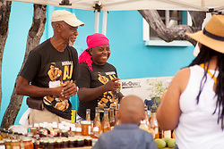 "Charles Leonard and Jeanne Fatie Delsoin sell fruits, vegetables, honies, and preserves.  The Festival & Cultural Organization of St. John Presents It's Annual Food Fair honoring Delroy ""Ital"" Anthony and Royal Coronation 2016.  Franklin A. Powell, Sr. Park.  St. John, US Virgin Islands.  26 June 2016.  © Aisha-Zakiya Boyd"