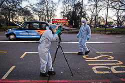 © Licensed to London News Pictures. 01/01/2019. London, UK. Police forensics on Park Lane after a man, reported to be a bouncer, was found stabbed on New Year's Day. Detectives have launched a murder investigation following his death. Two other men - aged 37 and 29 - and a 29-year-old woman were also found with stab injuries. They were treated at the scene before being taken to hospital; their injuries are not life threatening. Photo credit: Ben Cawthra/LNP